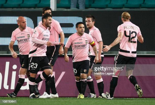 Fabrizio Miccoli of Palermo celebrates with teammates after scoring the opening goal of the Serie A match between US Citta di Palermo and Juventus FC...