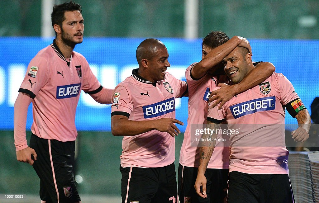 <a gi-track='captionPersonalityLinkClicked' href=/galleries/search?phrase=Fabrizio+Miccoli&family=editorial&specificpeople=702434 ng-click='$event.stopPropagation()'>Fabrizio Miccoli</a> (R) of Palermo celebrates with teammates after scoring the opening goal during the Serie A match between US Citta di Palermo and AC Milan at Stadio Renzo Barbera on October 30, 2012 in Palermo, Italy.