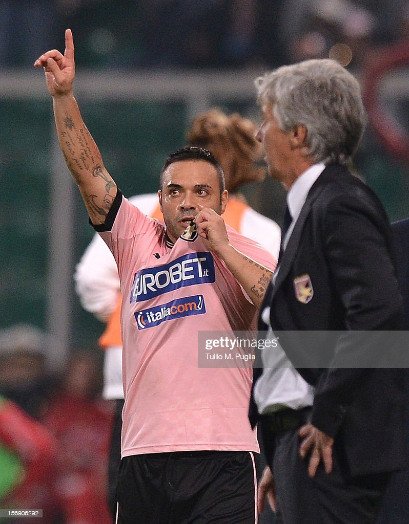 <a gi-track='captionPersonalityLinkClicked' href=/galleries/search?phrase=Fabrizio+Miccoli&family=editorial&specificpeople=702434 ng-click='$event.stopPropagation()'>Fabrizio Miccoli</a> of Palermo greets supporters during the Serie A match between US Citta di Palermo and Calcio Catania at Stadio Renzo Barbera on November 24, 2012 in Palermo, Italy.
