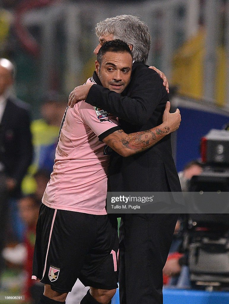 Fabrizio Miccoli of Palermo hugs Coach Gian Piero Gasperini during the Serie A match between US Citta di Palermo and Calcio Catania at Stadio Renzo Barbera on November 24, 2012 in Palermo, Italy.