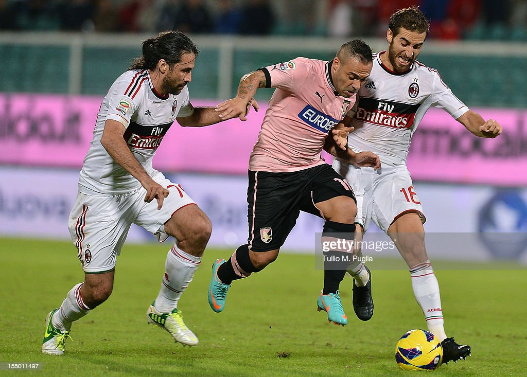 <a gi-track='captionPersonalityLinkClicked' href=/galleries/search?phrase=Fabrizio+Miccoli&family=editorial&specificpeople=702434 ng-click='$event.stopPropagation()'>Fabrizio Miccoli</a> (C) of Palermo is challenged by <a gi-track='captionPersonalityLinkClicked' href=/galleries/search?phrase=Mario+Yepes&family=editorial&specificpeople=648682 ng-click='$event.stopPropagation()'>Mario Yepes</a> (L) and <a gi-track='captionPersonalityLinkClicked' href=/galleries/search?phrase=Mathieu+Flamini&family=editorial&specificpeople=242961 ng-click='$event.stopPropagation()'>Mathieu Flamini</a> (R) of Milan during the Serie A match between US Citta di Palermo and AC Milan at Stadio Renzo Barbera on October 30, 2012 in Palermo, Italy.