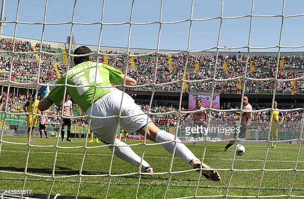 Fabrizio Miccoli of Palermo scores a penalty during the Serie A match between US Citta di Palermo and AC Chievo Verona at Stadio Renzo Barbera on May...
