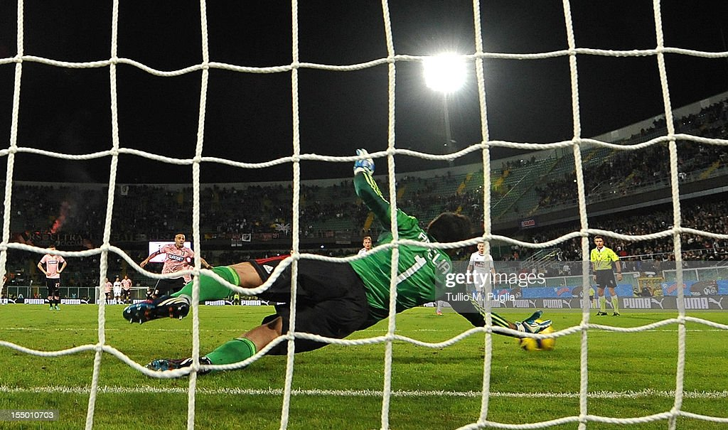 <a gi-track='captionPersonalityLinkClicked' href=/galleries/search?phrase=Fabrizio+Miccoli&family=editorial&specificpeople=702434 ng-click='$event.stopPropagation()'>Fabrizio Miccoli</a> of Palermo scores a penalty during the Serie A match between US Citta di Palermo and AC Milan at Stadio Renzo Barbera on October 30, 2012 in Palermo, Italy.