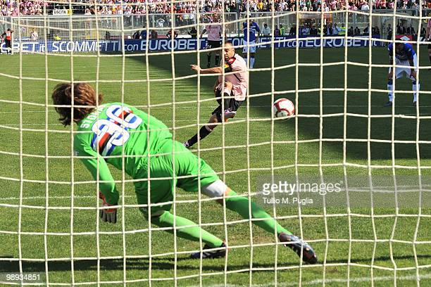 Fabrizio Miccoli of Palermo scores the 11 equalising goal from a penalty past Sampdoria's goalkeeeper Marco Storari during the Serie A match between...