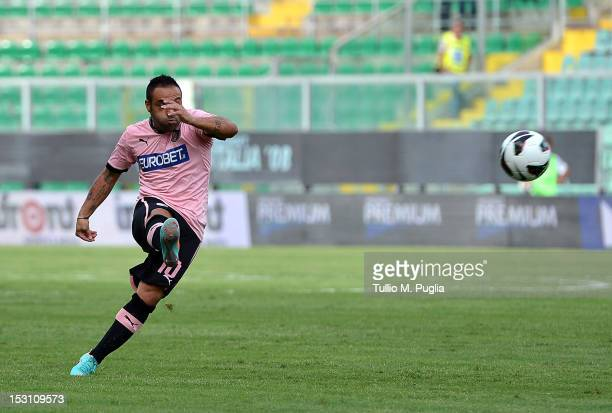 Fabrizio Miccoli of Palermo scores the opening goal during the Serie A match between US Citta di Palermo and AC Chievo at Stadio Renzo Barbera on...