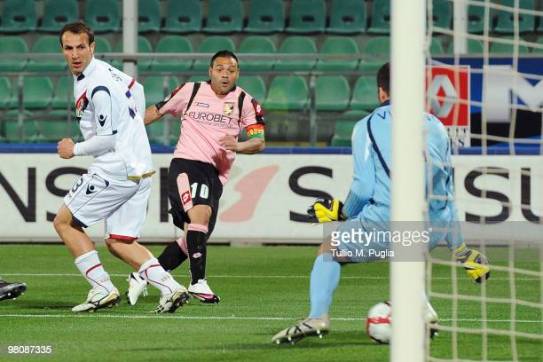 Fabrizio Miccoli of Palermo scores the opening goal during the Serie A match between US Citta di Palermo and Bologna FC at Stadio Renzo Barbera on...