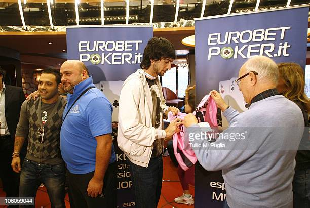 Fabrizio Miccoli poses with a fan while Javier Pastore signs a shirt on the ship for the opening tournaments of the Mediterranean Cruise Eurobetpoker...