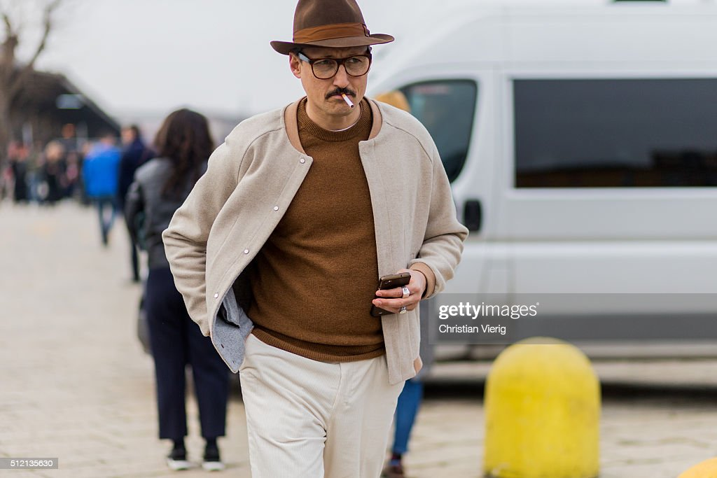 Fabrizio Oriani wearing a college jacket a Borsalino hat seen outside Gucci during Milan Fashion Week Fall/Winter 2016/17 on February 24 2016 in...