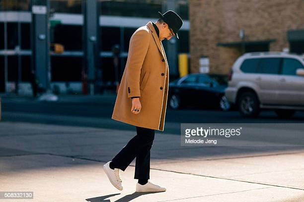 Fabrizio Oriani wears a Lardini total look including a camel coat with a Borsalino hat during New York Fashion Week Men's Fall/Winter 2016 on...