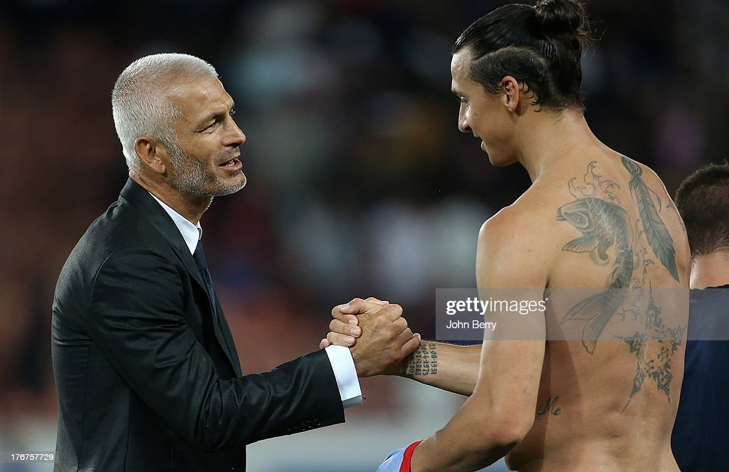 Fabrizio Ravanelli, coach of AC Ajaccio shakes hands and gets the jersey of Zlatan Ibrahimovic of PSG at the end of the Ligue 1 match between Paris Saint Germain FC and AC Ajaccio at the Parc des Princes stadium on August 18, 2013 in Paris, France.