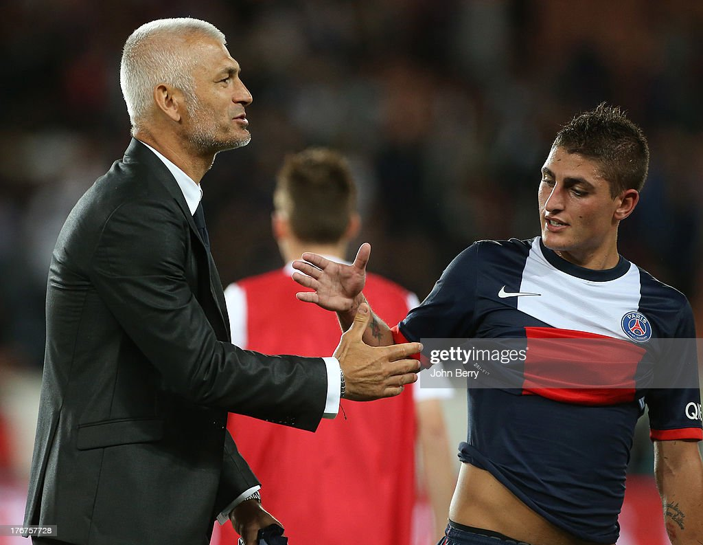 Fabrizio Ravanelli, coach of AC Ajaccio shakes hands with Marco Verratti of PSG at the end of the Ligue 1 match between Paris Saint Germain FC and AC Ajaccio at the Parc des Princes stadium on August 18, 2013 in Paris, France.