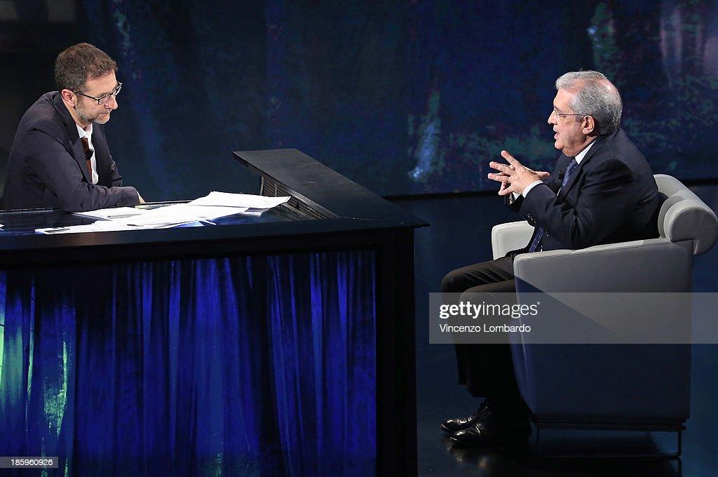 Fabrizio Saccomanni (R) speaks to <a gi-track='captionPersonalityLinkClicked' href=/galleries/search?phrase=Fabio+Fazio&family=editorial&specificpeople=774725 ng-click='$event.stopPropagation()'>Fabio Fazio</a> during tv show 'Che Tempo Che Fa' on October 26, 2013 in Milan, Italy.
