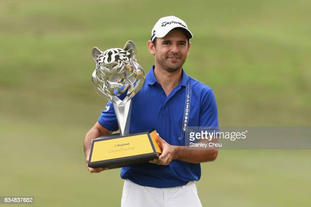 Fabrizio Zanotti of Paraguay celebrates with the Maybank Championship trophy after winning by 19 under par 269 during Day Four of the Maybank...