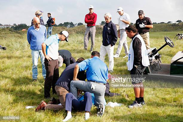 Fabrizio Zanotti of Paraguay is attended to by medical staff after being struck with a ball while Alexandre Kaleka of France who hit the shot looks...
