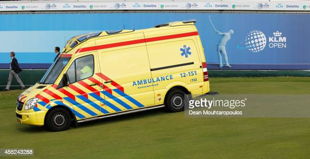 Fabrizio Zanotti of Paraguay is taken away by an ambulance after being struck with a ball by a tee shot by Alexandre Kaleka of France during Day 1 of...