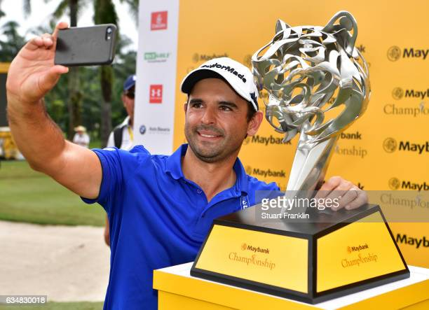 Fabrizio Zanotti of Paraguay makes a selfie with the winners trophy after the final day of the Maybank Championship Malaysia at SaujanaGolf Club on...