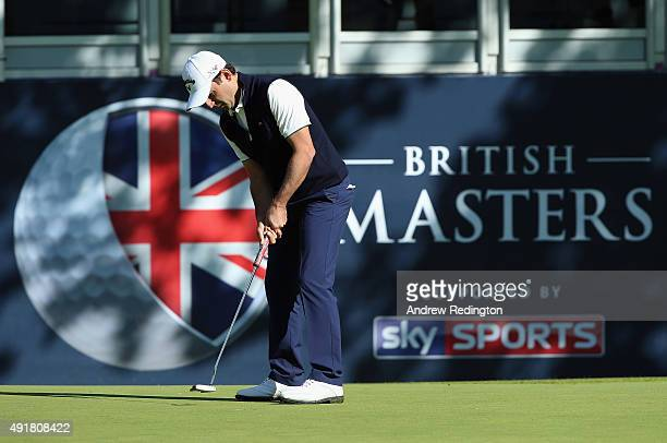 Fabrizio Zanotti of Paraguay putts on the 18th green during the first round of the British Masters supported by Sky Sports at Woburn Golf Club on...