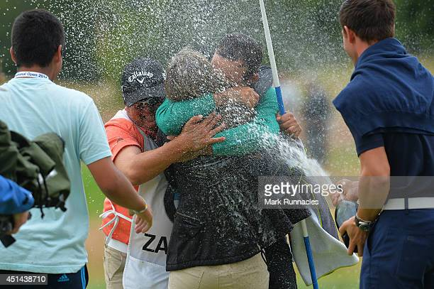 Fabrizio Zanotti of Paraguay winner of the BMW International Open celebrates his win on the 17th green after a play off with Henrick Stenson of...