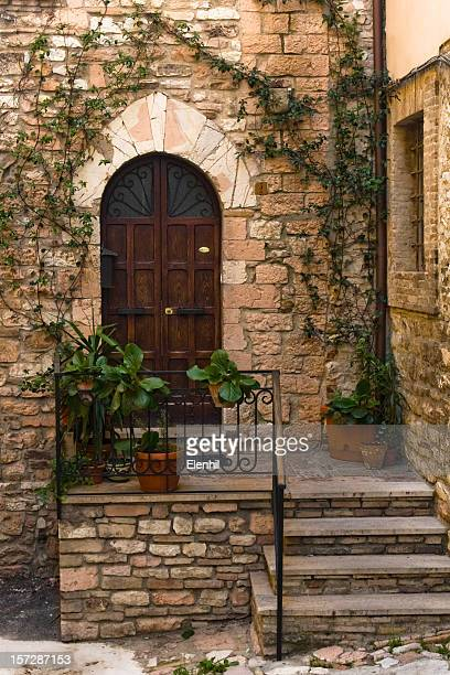 Facade and door of a medieval-looking Italian house