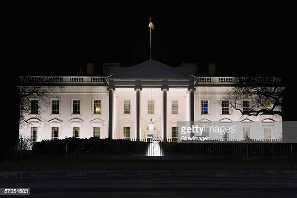 Facade of a government building lit up at night, White House, Washington DC, USA
