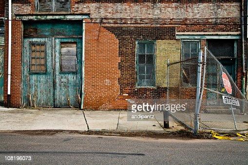 Facade of a grungy abandoned urban warehouse