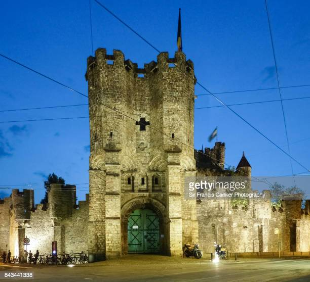 Facade of Castle of the Counts illuminated at night in Gent, Belgium