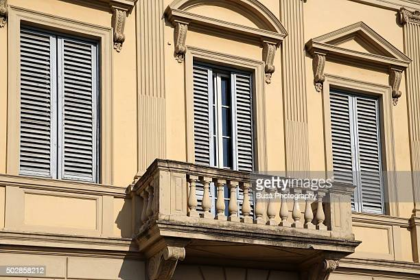 Facade of elegant residential building on the Lungarno (Arno river banks) area of Florence, Italy