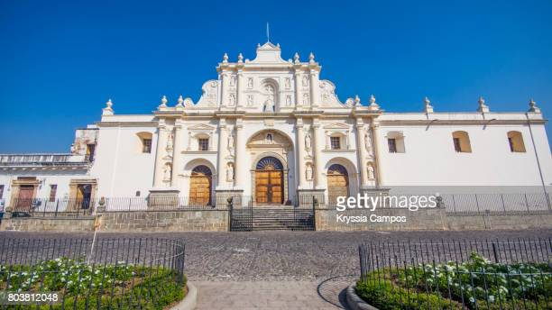 Facade of Saint Joseph Cathedral in front of the Central Park in Antigua Guatemala