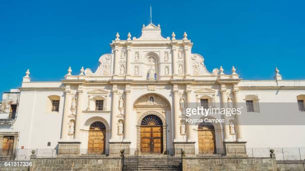 Facade of Saint Joseph Cathedral or Catedral de San José in front of the Central Park in Antigua Guatemala