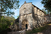 Front view of the stone facade of the Monastery of Santa Cristina de Ribas de Sil in the Ribeira Sacra in Ourense, Galicia.