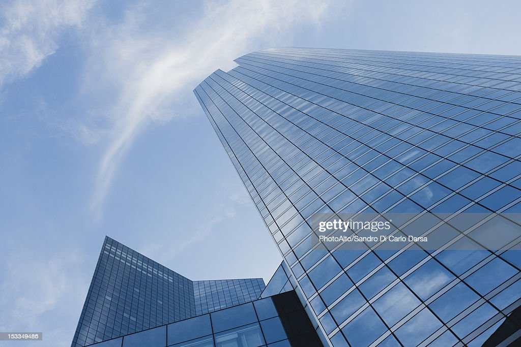Facade of skyscrapers against sky, low angle view : Stock Photo