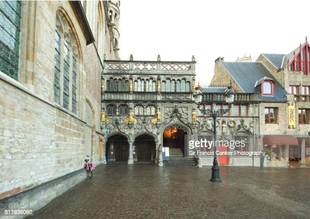 Facade of the Basilica of the Holy Blood in Romanesque and Gothic architectural styles in Bruges, Belgium, a UNESCO Heritage Site