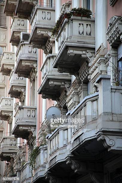Facade with balconies of Art Nouveau building in Milan, Italy
