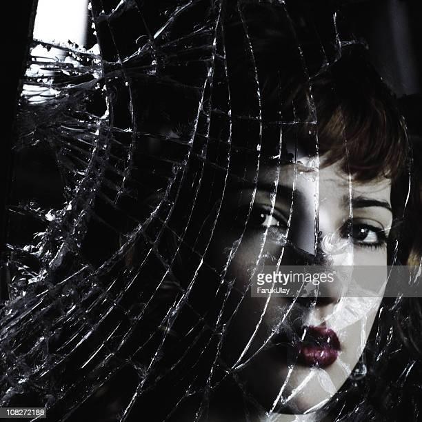 Face Behind Broken Glass