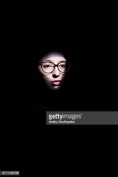 A face in darkness