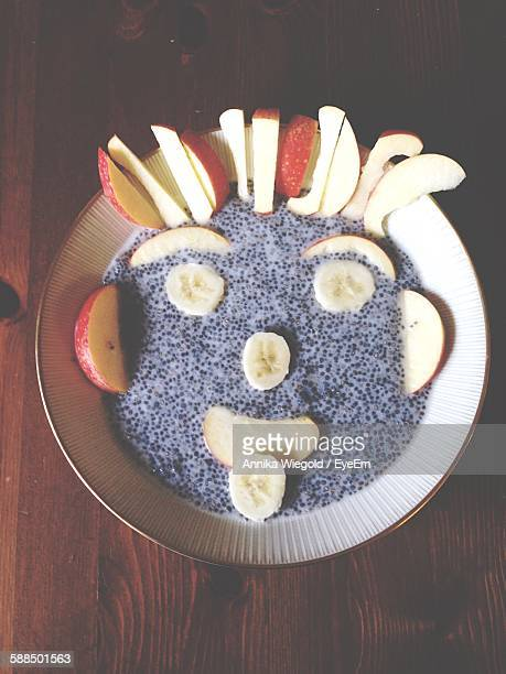 Face Made By Sliced Apples On Chia Mousse In Plate At Home