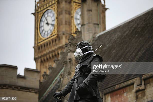 A face mask is placed on the statue of Oliver Cromwell outside Parliament by Greenpeace protesters on April 18 2016 in London England The...