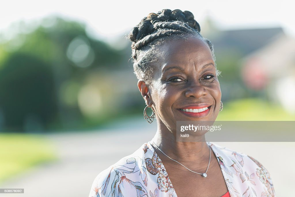 Face of a mature African American woman outdoors : Stockfoto