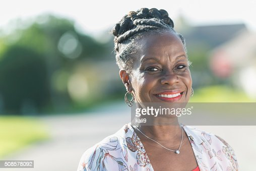 Face of a mature African American woman outdoors : Stock Photo