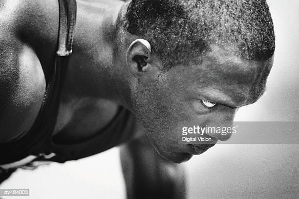 Face of runner in starting blocks