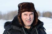 Face of calm senior man in winter