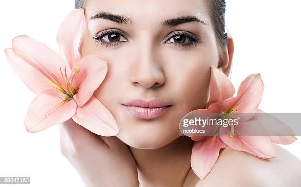 Face of woman with flower