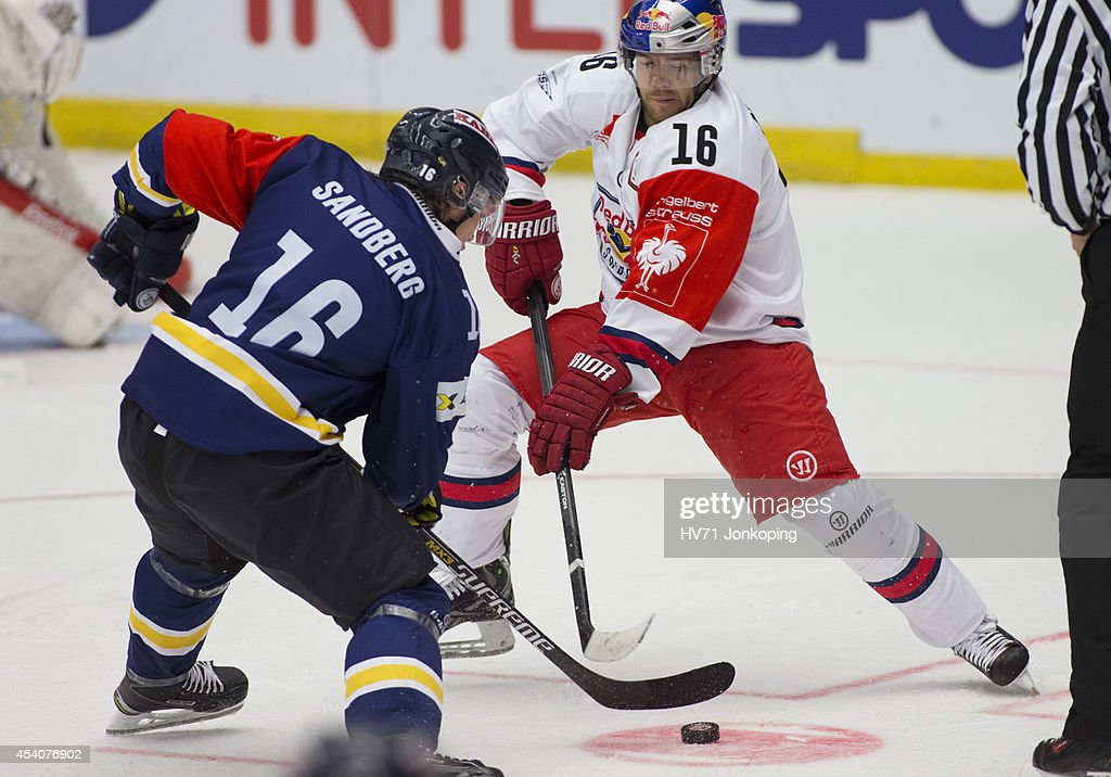 Face off between Filip Sandberg #16 of HV71 and Ryan Duncan #16 of Red Bull Salzburg during the Champions Hockey League group stage game between HV71 Jonkoping and Red Bull Salzburg on August 24, 2014 in Jonkoping, Sweden.