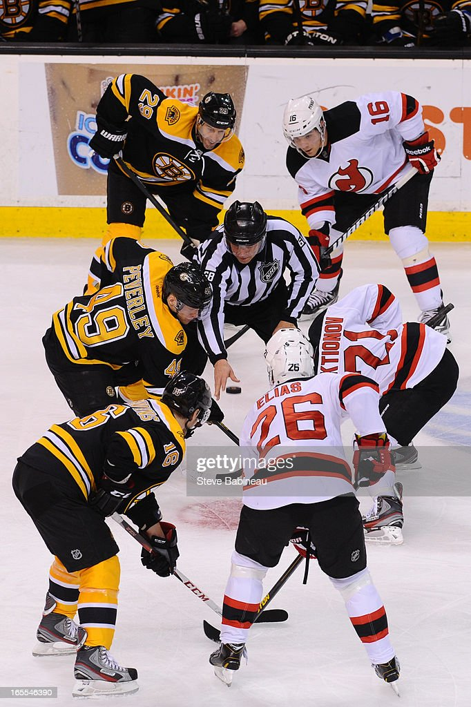 Face off of the Boston Bruins against the New Jersey Devils at the TD Garden on April 4, 2013 in Boston, Massachusetts.