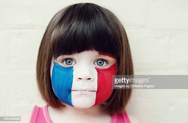 Face painted of French flag