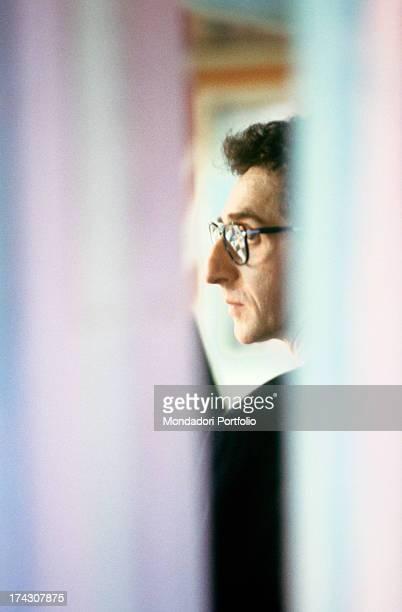 Face profile closeup of the Italian songwriter Francesco Battiato known as Franco Battiato through a curtain Italy 1988
