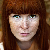 Face shot of beautiful red woman with freckles