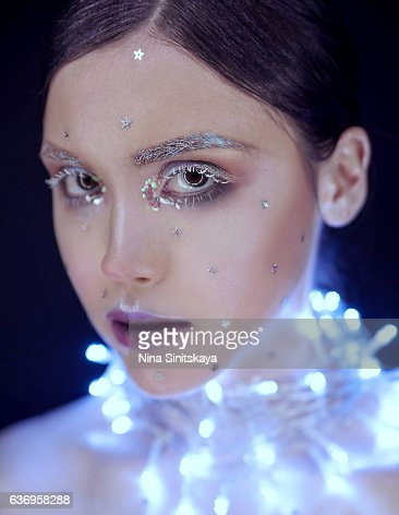 Face shot of girl with christmas lights on her neck