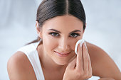 Face Skin Care. Beautiful Woman Removing Makeup With Cosmetic Cotton Pad, Cleaning Facial Skin. High Resolution