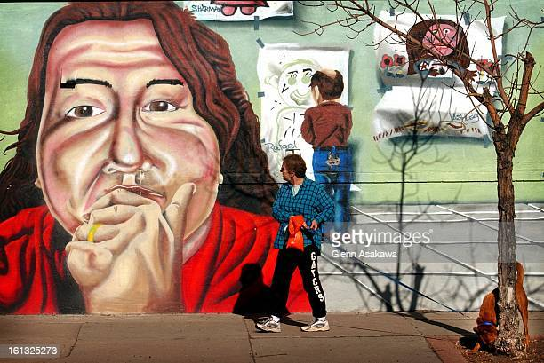 FACE12201Emily Magner a volunteer with Maxfund animal shelter 1041 Galapago St views a mural on the side of a building near 8th Ave and Inca St...